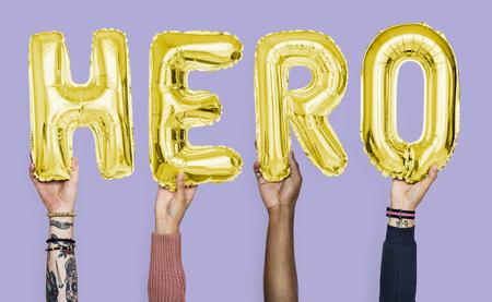 Hands showing hero balloons word Stockfoto - 105410989