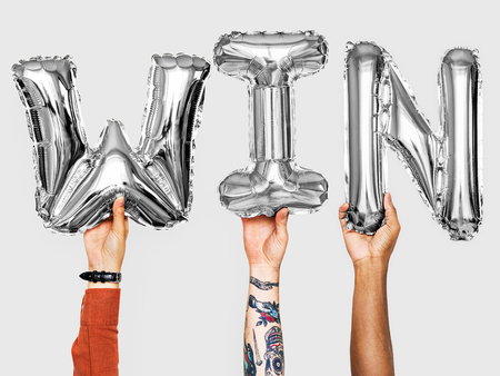 Hands showing win balloons word