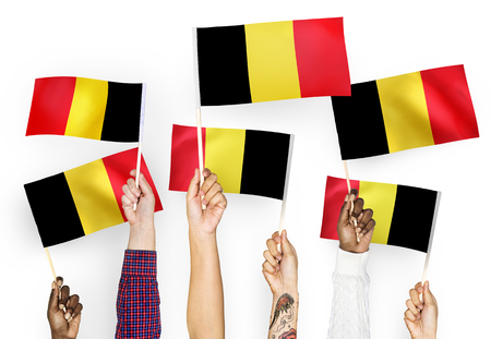 Hands waving the flags of Belgium 版權商用圖片