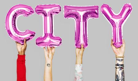 Hands showing city balloons word Archivio Fotografico - 105411405