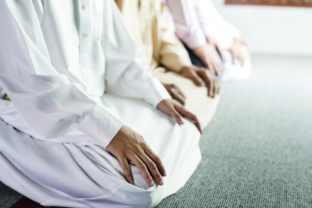 Muslim prayers in Tashahhud posture