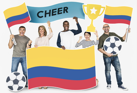 Diverse football fans holding the flag of Colombia