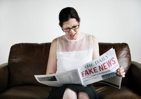 A woman reading fake news
