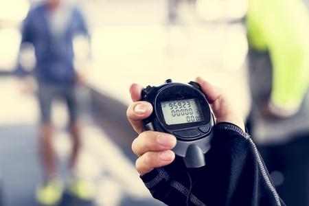 Closeup of hand holding stopwatch Stock Photo