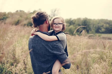 Caucasian dad having fun with daughter Stock Photo - 106300217