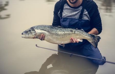 Man caught salmon fish Stock Photo