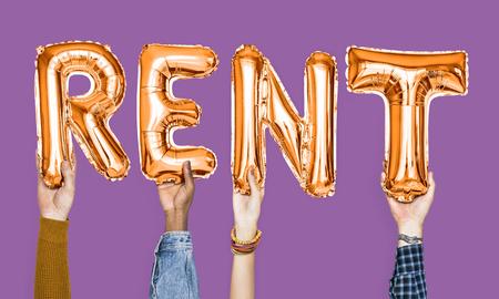 Orange alphabet balloons forming the word rent Standard-Bild - 106301672