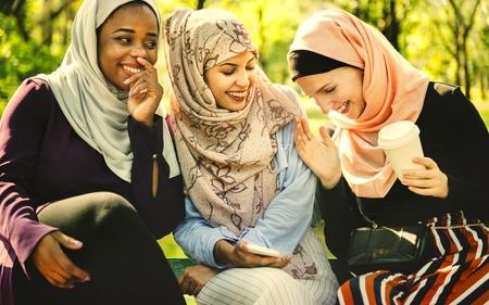 Young muslim girls laughing and having fun Stock Photo