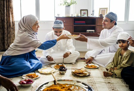 Muslim family having dinner on the floor Stock Photo