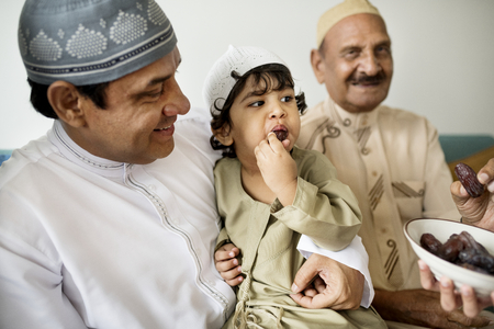 Muslim family having dried dates as a snack Stock Photo - 106302588
