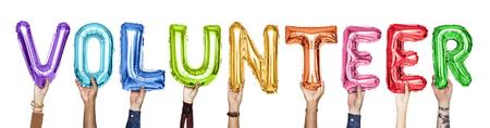 Rainbow alphabet balloons forming the word volunteer