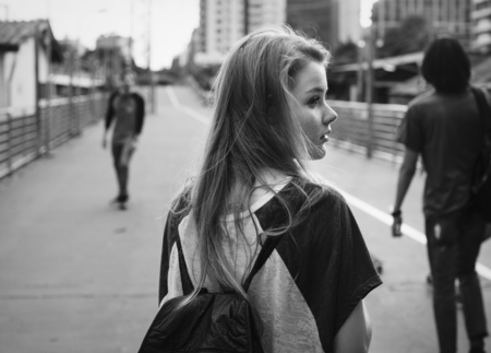 A young woman wandering on the street