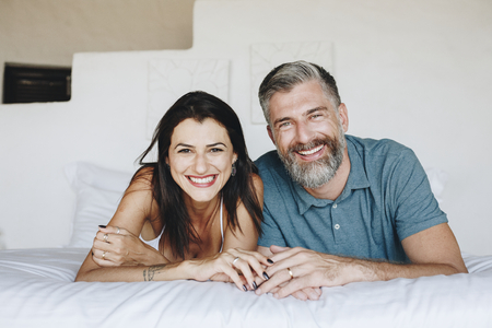 Couple spending their honeymoon in bed Stock Photo