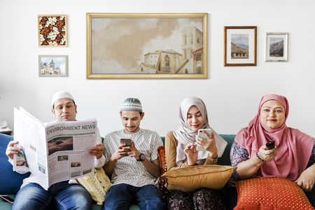 Muslim family reading the news Stock Photo - 106350220