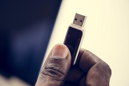 Hand holding Universal Serial Bus portable data backup