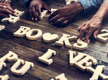 A wooden alphabet books word on the table Stockfoto