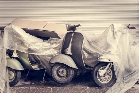 Old scooter parked on a street Banco de Imagens - 106350705