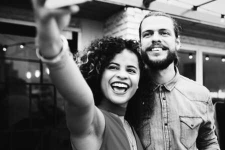 Couple taking selfie at a party