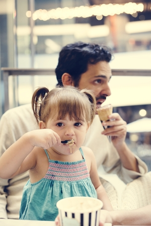 Family eating ice-cream together Stock Photo