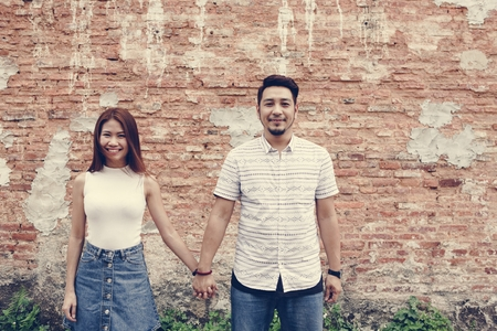 Asian couple holding hands together