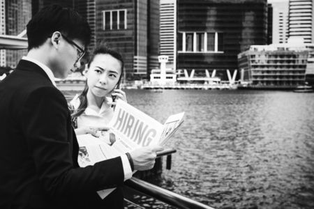 Asian business people in a city working together Archivio Fotografico - 106357184
