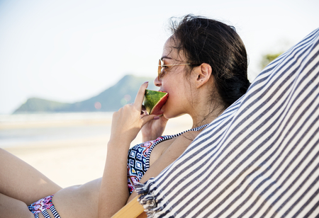 Young woman relaxing at a resort Stock Photo