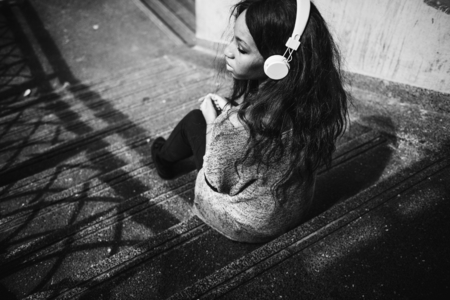 African American woman is listening to music
