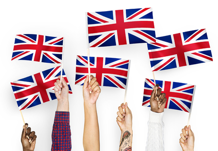 Hands waving the Union Jack