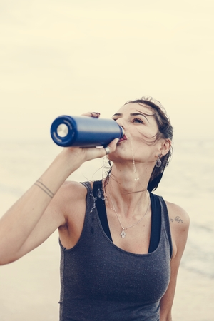 Woman drinking water after a workout