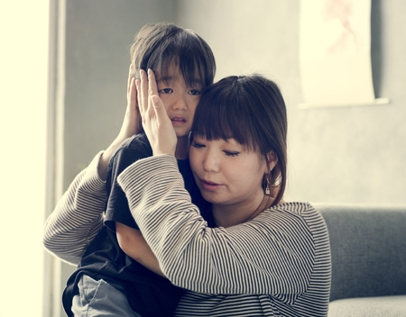 Japanese mother comforting her daughter