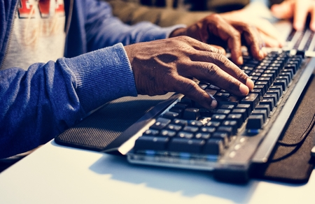 Closeup of hands working on computer keyboard Banco de Imagens