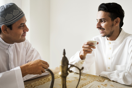 Muslim men having a cup of tea Stock Photo - 106367823