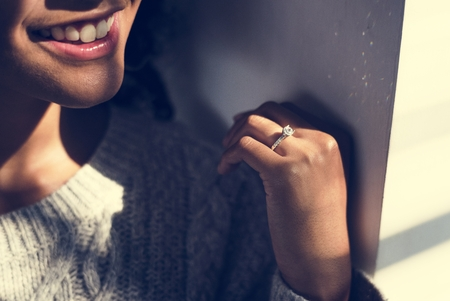 Cheerful woman with engagement ring Stock Photo - 106368070