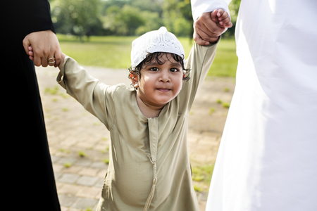 Cheerful Muslim boy in the park Stock Photo