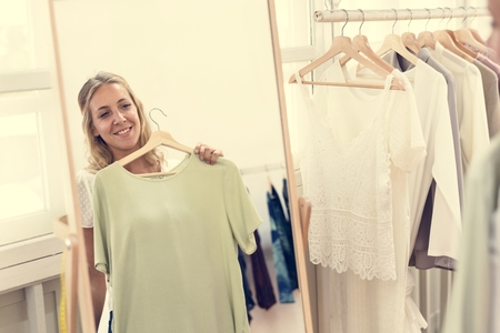 Woman checking out clothes