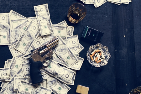 Gun on money on the table