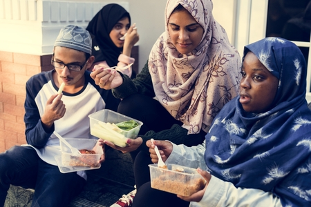 A group of diverse students are having lunch together Stock Photo