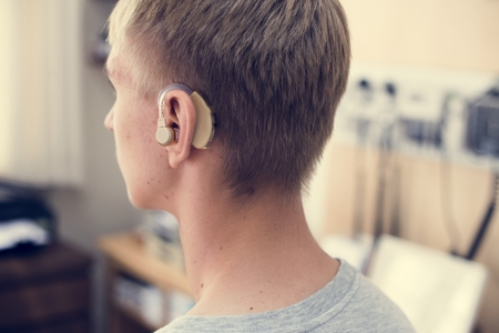 Young man with hearing aid Stock Photo