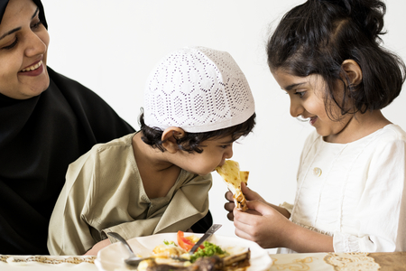 Muslim family having a meal