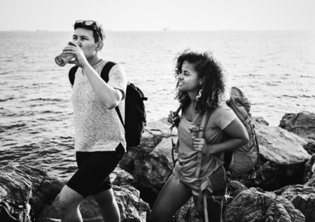 Young couple traveling together by the sea