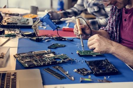 Hand soldering tin on electronics circuit board Banco de Imagens - 106374701