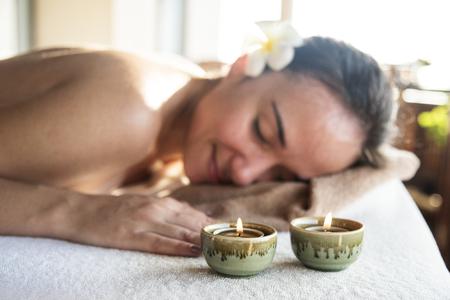 Woman enjoying a relaxing massage at a spa Stock fotó