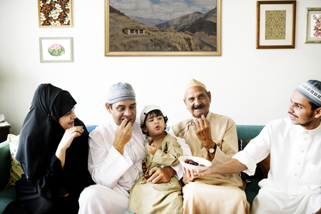 Muslim family having dried dates as a snack Stock Photo - 106374914