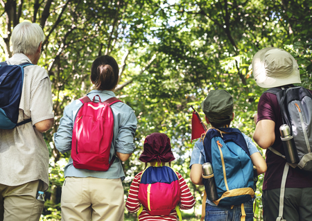 Family hiking in a forest Stock Photo