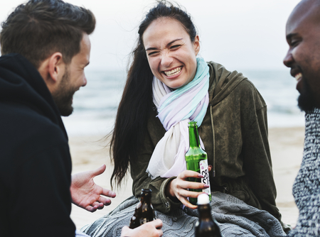 Friends drinking beer on the beach Stock Photo