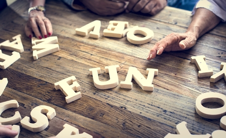A wooden alphabet fun word on the table