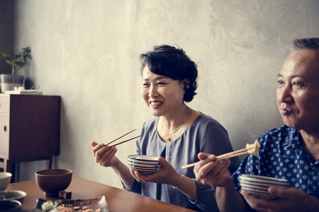 Japanese family dining together with happiness
