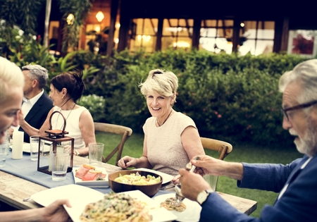 Group of diverse friends are having a dinner together Stock Photo