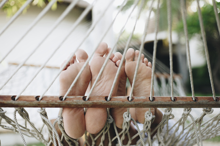 Couple resting together in a hammock Stock Photo