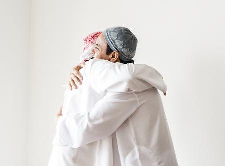 Muslim men hugging each other Reklamní fotografie